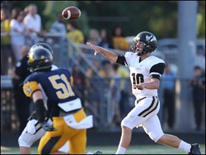 Perrysburg QB Gus Dimmerling (10) throws the ball.