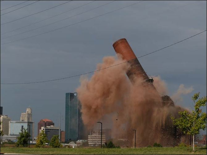 CTY implosion30p4 teaser A portion of the last smokestack at the site of the former Toledo Edison Power Plant in East Toledo is imploded Friday.