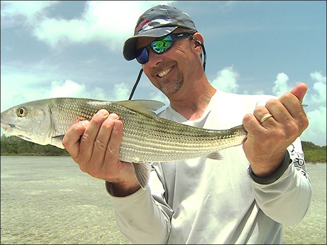 markey29p Ohio State football coach Urban Meyer with a bonefish he caught July 2013 while fishing in the flats of the Abacos Islands in the Bahamas.