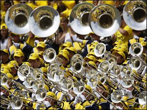 The Michigan band performs during Appalachian State game at the Michigan Stadium in Ann Arbor, Mich.