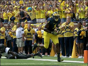 Michigan's Devin Funchess evades Appalachian State's Jordan Ford on this touchdown.