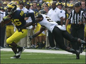 Michigan's Jehu Chesson is chased by Appalachian State's Dante Blackmon.