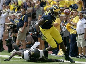 Appalachian State's Jordan Ford misses a tackle on Michigan's Devin Funchess.