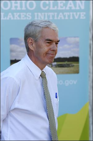Senator Randy Gardner (R) - District 2, listens to speakers during a press conference concerning new efforts to improve water quality in Lake Erie.