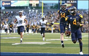 University of Toledo WR Corey Jones (4) scores a touchdown against New Hampshire during the second quarter of a football game at the Glass Bowl Saturday.