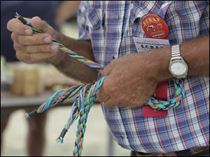 Ken Jahns of Fremont, ties a handle onto a just-made rope.