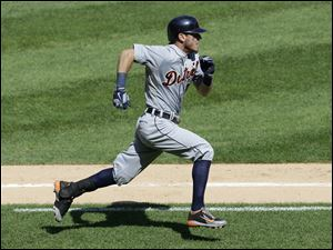 Detroit Tigers' Ian Kinsler (3) runs to second base after hitting an RBI double.