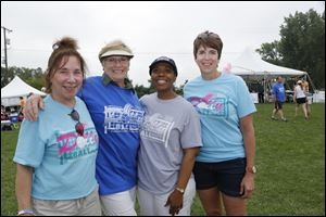 Committee members Lynn Kordash, left, Joey Apgar, Lisa McDuffie, and Jeannie Hylant at the 23rd Annual Pollyball Tournament, in celebration of the life of Polly Hylant-Tracy.