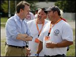Ed FitzGerald, Democratic candidate for Ohio governor, talks with John Mickey, political director of the Greater Northwest Ohio AFL-CIO, center, and Chris Monaghan, president of the Northwest Ohio AFL-CIO, right, during the Northwest Ohio Laborfest.