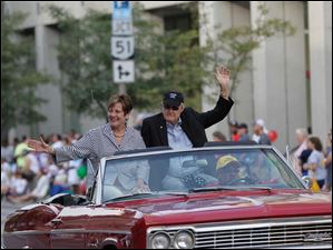 Francine, left, and Dal Lawrence, the Toledo Federation of Teachers' first two presidents, wave as grand marshals this year's parade.
