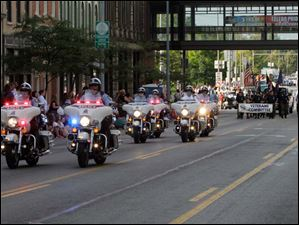 The motorcycle unit of the Toledo Police Department leads the annual Labor Day parade in downtown Toledo.