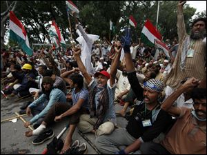 Supporters of anti-government Muslim cleric Tahir-ul-Qadri chant slogans as they stage a sit in protest close to Prime Minister's home in Islamabad, Pakistan today.