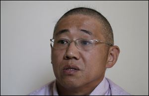 Kenneth Bae, an American tour guide and missionary serving a 15-year sentence, is detained in North Korea.