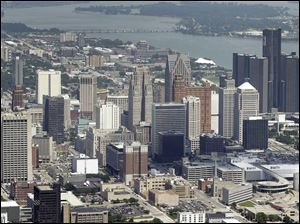 With billions in debt, Detroit on Tuesday began its federal bankruptcy trial.