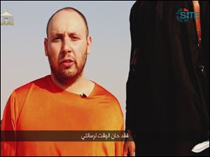 "This image from video posted on the Internet by Islamic State militants purports to show U.S. journalist Steven Sotloff before he was beheaded. The Arabic text at the bottom of the frame translates to ""Now is the time for my message."""