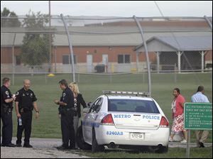 Police work in front of the Woodland Hills Youth Development Center Tuesday, Sept. 2, 2014, in Nashville, Tenn.