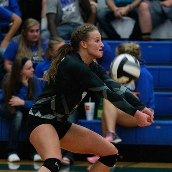 SPT-elmwoodvball03pOtsego-s-Abby-Hesselschwardt-returns-a-serve