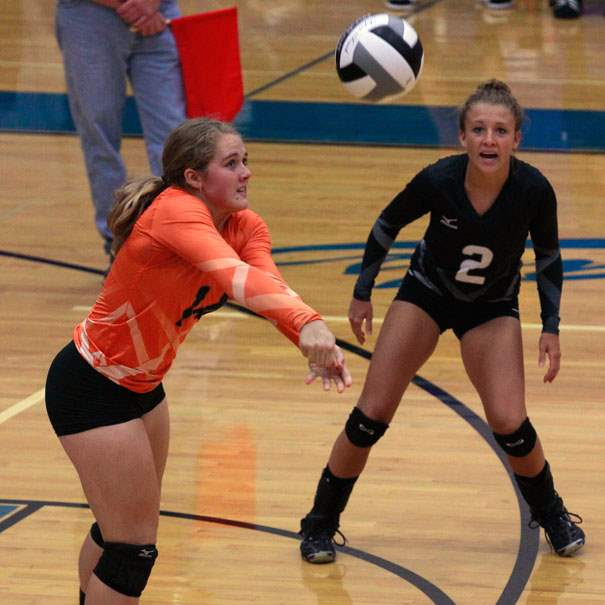 SPT-elmwoodvball03pOtsego-s-Kylie-Asmus-returns-a-serve-in-fr