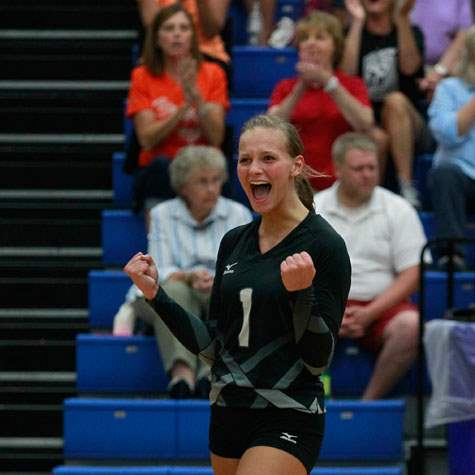 SPT-elmwoodvball03pvOtsego-s-Abby-Hesselschwardt-reacts-to-a-point