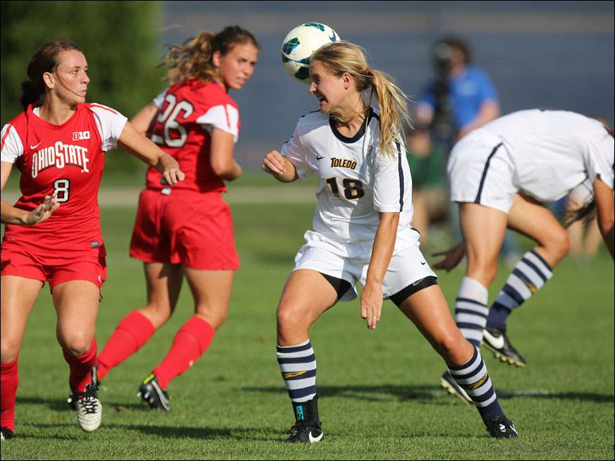 University of Toledo's Alexis Tice (18) moves the  ball against Ohio State's Kayla Varner (8).
