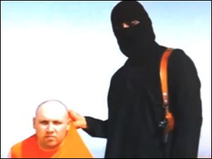 In this image from an undated video released by Islamic State militants Tuesday, purports to show journalist Steven Sotloff being held by the militant group.