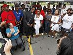 A crowd  rallies in front of a Walmart store in Beavercreek, Ohio, on  Aug. 30, in memory of John Crawford III, who was shot and killed by police at the store on Aug. 5.