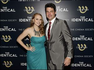 Actress Erin Cottrell, left, and actor Blake Rayne, star in 'Identical.'
