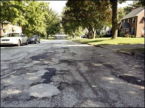 Above, the 2900 block of Algonquin Parkway in Toledo is on a list of 12 Toledo streets in Districts 1 and 3 to be repaved.