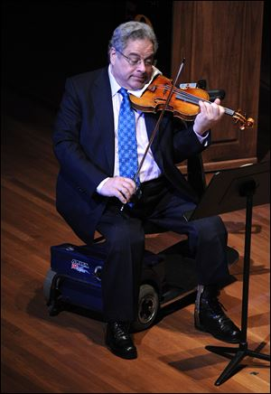 Violinist Itzhak Perlman will perform at 6 p.m. Sept. 14 in Hill Auditorium, Ann Arbor.