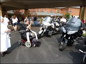 Rev. Joseph Weigman, chaplain at Sacred Heart Home, blesses the motorcycles at the Car Show & Motorcycle Run for the Little Sisters of the Poor.