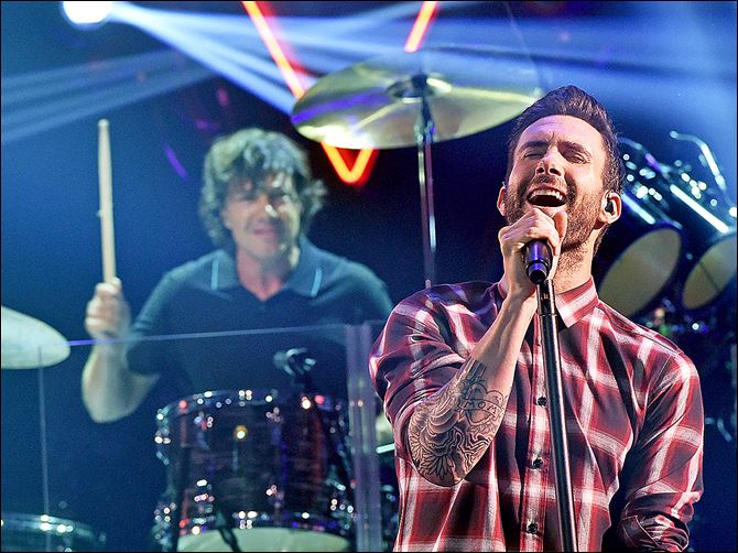 Drummer Matt Flynn and singer Drummer Matt Flynn and singer Adam Levine of Maroon 5 perform onstage during the iHeartRadio Album Release Party in Burbank, Calif.