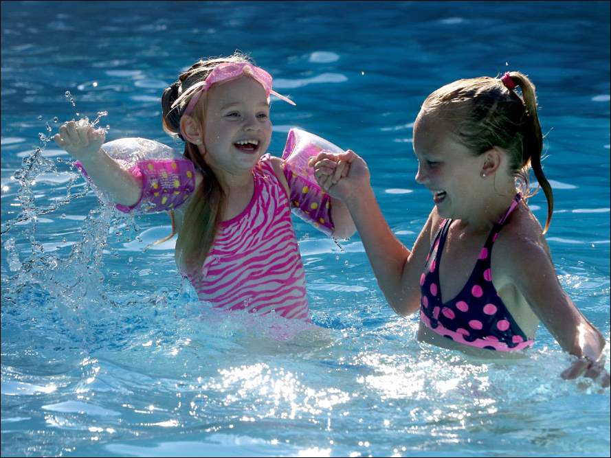 Sisters Hope Hayes, 4, left, and Madison Lemke, 10, swim together Friday, Sept. 5, 2014, at Jamestown of Toledo Apartment Homes in West Toledo.