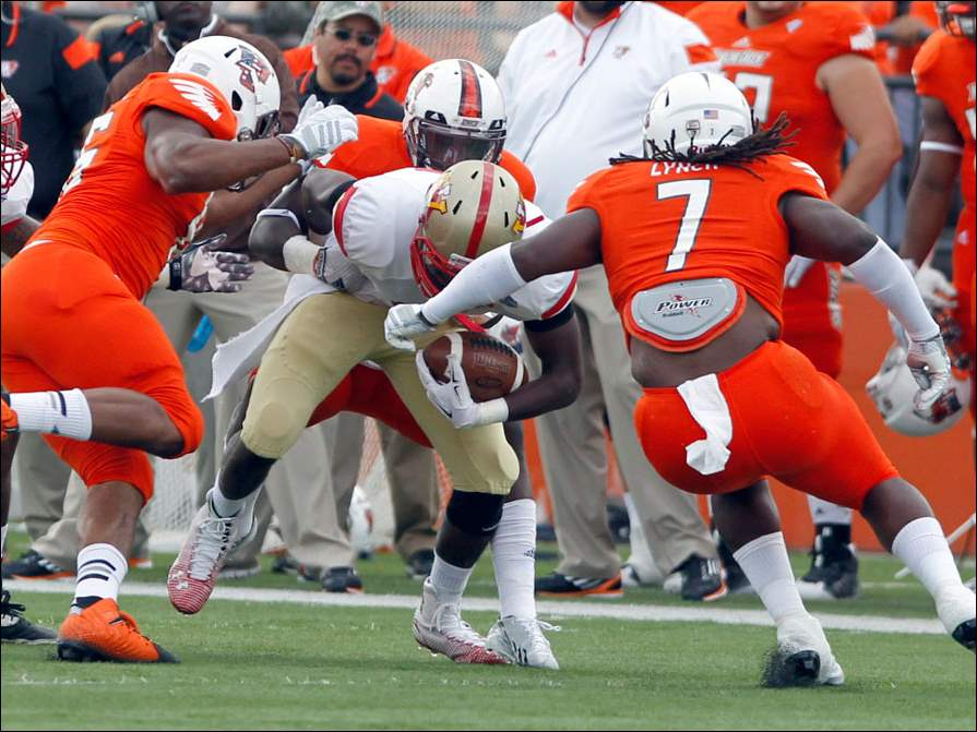 BGSU's  D.J. Lynch, #7, and the defense takes down VMI's Deon Watts.
