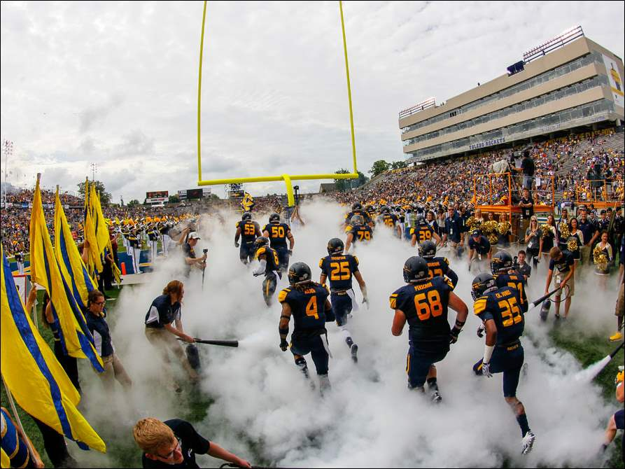 University of Toledo Rockets take the field to play the Missouri Tigers.