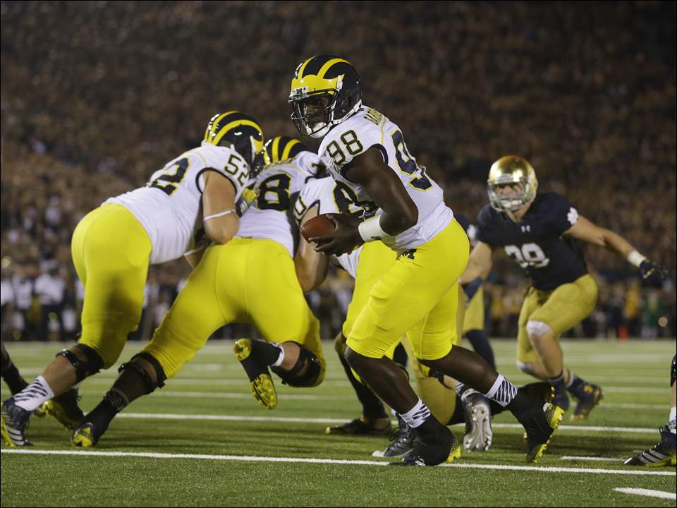 Michigan quarterback Devin Gardner drops back against Notre Dame.