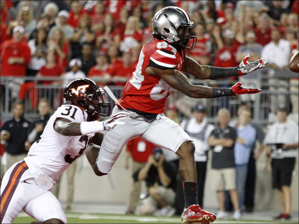 Ohio State wide receiver Corey Smith, right, drops a pass as Virginia Tech cornerback Brandon Facyson defends.