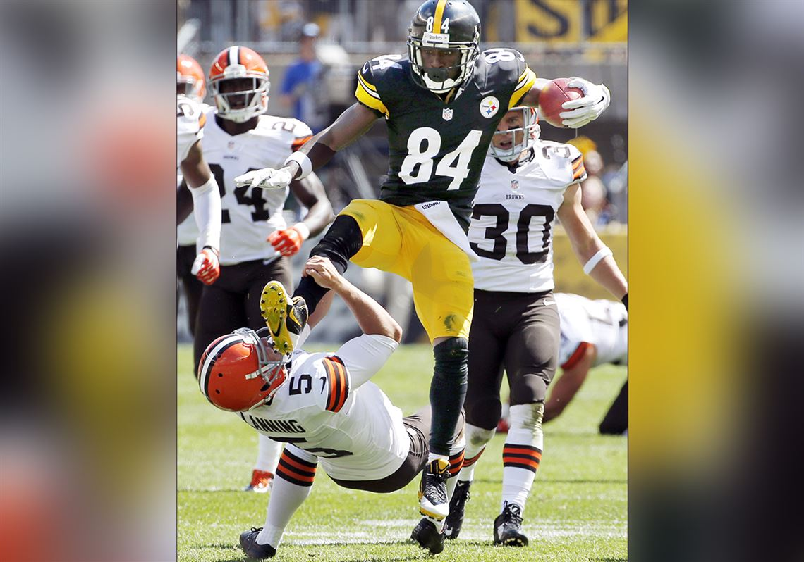 dd5823c06 Pittsburgh Steelers Antonio Brown kicks Cleveland Browns punter Spencer  Lanning as he jumps while returning a