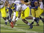 Michigan quarterback Devin Gardner recovers his fumble during the first half against Notre Dame in South Bend, Ind.