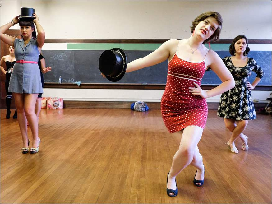Left to right Lesli Smarszcz, Lindsey Miller, and Sarah Hammye of the T-Town Tassels rehearse.