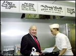S. Truett Cathy, founder of Chick-fil-A, poses in a replica of