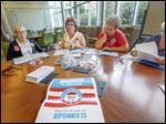 Darcy Yates, co-vice president of the League of Women Voters of Toledo-Lucas County, center left, starts a voter-registration training session with members of the Toledo-Lucas County league including, from left, Bonnie Bishop and Kathy Chamberlain and Anne Moss, who is not a member.