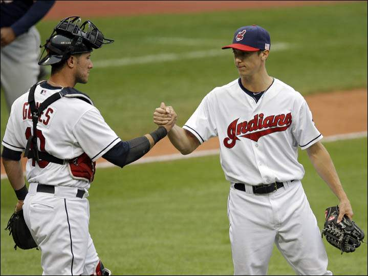 Cleveland Indians catcher Yan Gomes, left, congratulates relief pitcher Kyle Crockett after an 8-2 win over the Minnesota Twins in the first game.
