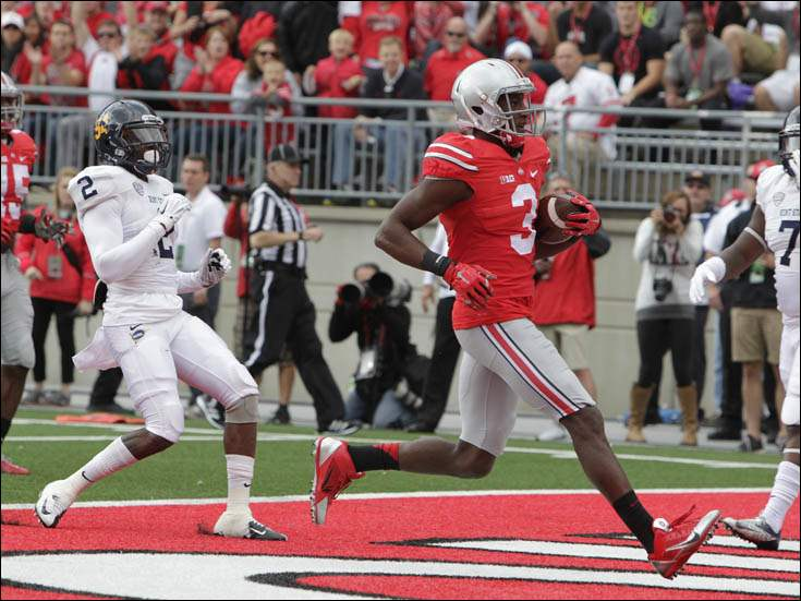 Ohio State wide receiver Michael Thomas, right, scores a touchdown past Kent State cornerback Malcolm Pannell.