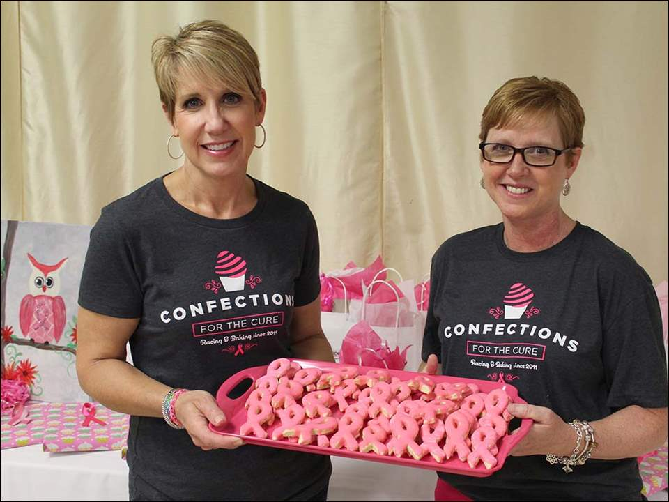 Liz Allen and Kelli Andres with her Pink Ribbon cut-out cookies.