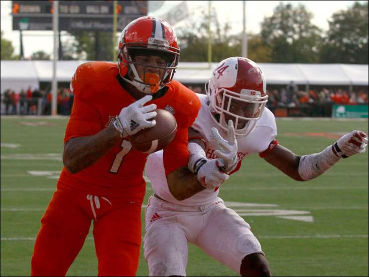 BGSU's Roger Lewis, with pressure from Indiana's Tim Bennett, catches the winning touchdown pass with 11 second left in the game.