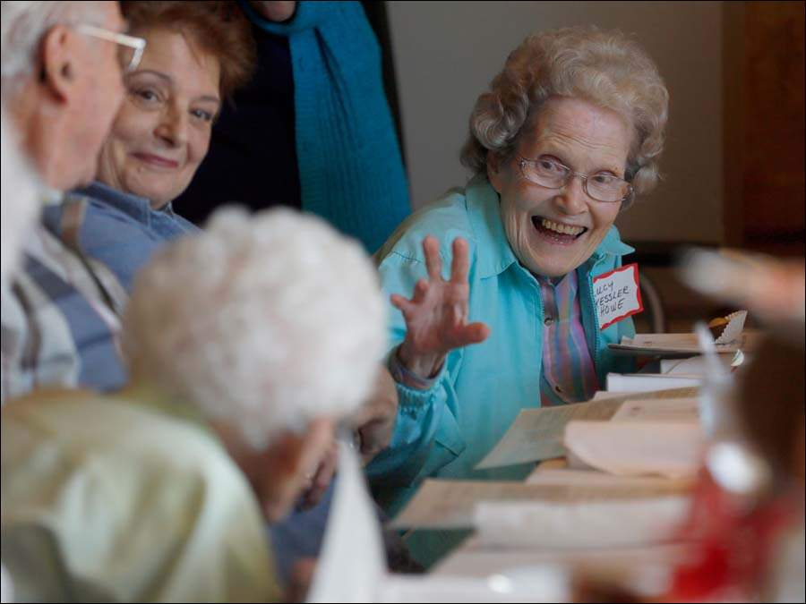 Lucille Kessler Howe waves to classmates at the table during the first ever 75th reunion of the 1939 Central Catholic High School graduating class at  Bravo restaurant.