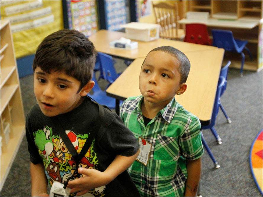 Preschoolers Hector Sanchez, left, and Adaris Norrington line up.