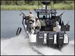 Law enforcement officials patrol on the Rio Grande along the U.S.-Mexico border this month in Mission, Texas.