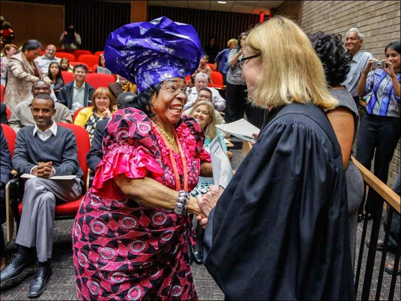 Priscilla Maduoma, originally from Nigeria, dances her way up to Judge Mary Ann Whipple to receive her Certificate of Citizenship.