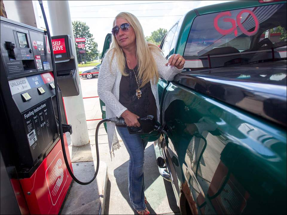 Denise Cole of North Toledo pumps gas at Speedway, 2502 W. Alexis Road in Toledo.